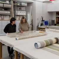 Lucy Commoner discussing a treatment with textile conservator Kira Eng-Wilmot in the textile conservation laboratory,  Cooper Hewitt, Smithsonian Design Museum