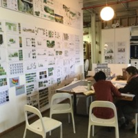 Designers at the conference table, Future Green Studio, Brooklyn, New York, 2016